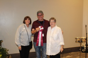 ACA Volunteer League Best of Show Award ($6,000) to William Kidd, ceramics, presented by IMAGES Coordinator Nance Koch and ACA Volunteer League President Sue Flynn.