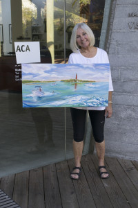 "IMAGES Artist Cathy Berse with her original plein air painting, ""Fun in the Sun"", 15""x 30"""
